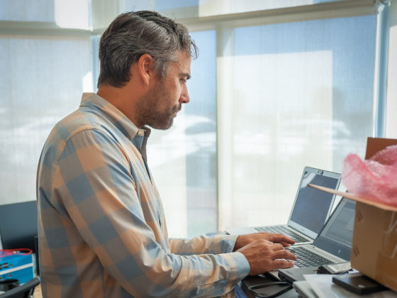 managed services handsome man working on laptop